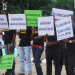 BATN (Youths) protesters cover faces during NTCB public hearing.